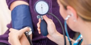 a stethoscope to measure Blood pressure